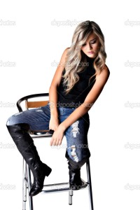 beautiful woman in torn jeans and leather boots