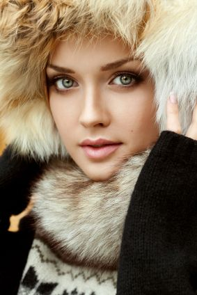 Portrait of a fresh and lovely woman wearing fur hat